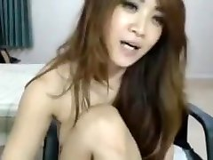Asian with a dildo with cream