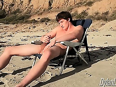 Sexy Lance Alexander strokes his meat on a secluded beach