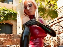 Fetish doll puts on Latex gloves and rubs scat shit mouth dress and tights