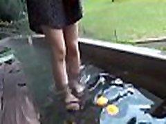 Wicked oriental girl enjoys double penetration outdoors