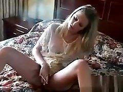 Sexy blonde honey lights a cigarette