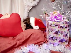 Cute Curly Girl Plays With Her Christmas Present