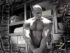 Bald sexy bodybuilder posing nude