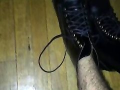Gay twink wears kinky leather combat boots and shows off his feet again!!