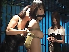 Poor Asian lady awaits her punishment in a dungeon