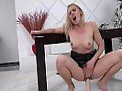 Blonde MILF takes on huge dildo
