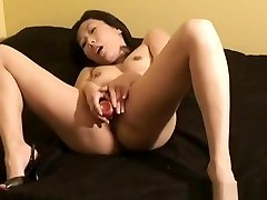 Hot and horny mature Asian slut with dildo