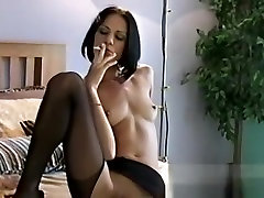Lewd wench shows pussy and relaxes herself with a cigarette