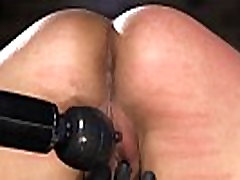 Shackled beauty pussy vibrated in dungeon