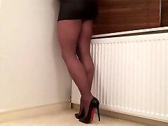 Black pantyhose legs .