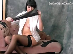 Babe with big tits in nylons and two pairs of leather gloves fetish tease