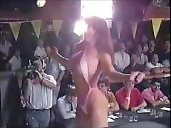 Hot brunette in tiny thong bikini c. 1988
