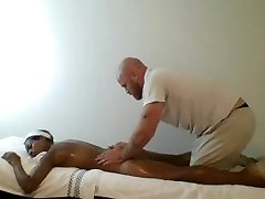 Ebony mom and survant massaged & finger banged by muscled masseur
