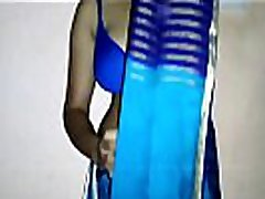 Indian aunty saree draping showing side boobs