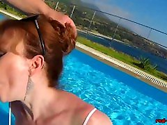 British Mature Red lady attorney sucking cock in a pool
