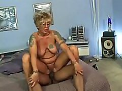 Mature blonde Raunchy Rita gets slammed hard by a young black stud