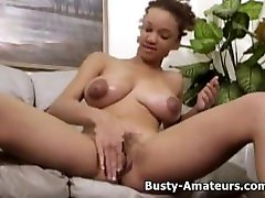 Busty Gia strips and masturbates her pussy