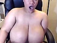 Big boobed Latina MeganBig52dd rubbing her pussy and shaking her enourmous tits