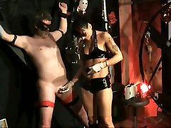 Inserting male slaves cock