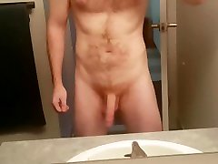 well hung red head plays with his flaccid cock until its a hard 9