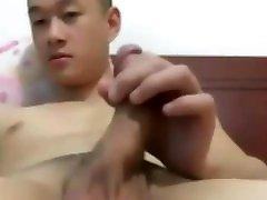 a chinese bigcock muscock handjob
