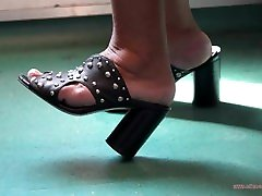 Candid feet of latina asia model woman feet in train with high-heeled clogs