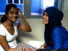 Sri lankan muslim girl & sinhala girl kissing.