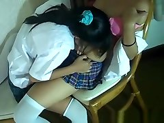 Asian lesbians are sucking and kissing on each others titties