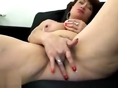 Hairy usa porn milf glo pleasures herself on the sofa