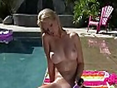 Blonde babe in bikini masturbating hard