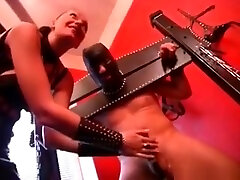 He Is In Chains While His Huge Cock