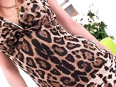 Super shooting leg babe in a leopard print dress bends over to show you her panties