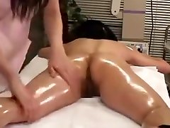Sultry babe with a sublime ass gets her body greased up by