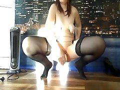 Mature brunette woman penetrates her cunt with a big toy