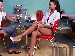 Ebony teen gives footjob