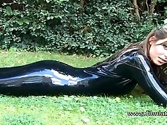 Sexy glamour babe Ellis outdoor latex fetish and sfw softcore beauty in high heel boots and tight rubber latexsuit outsi