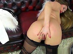 British milf Heidi slides a finger up her fanny