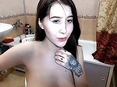 Amateur homemade porn with a busty brunette and tit cumshot on SexoWebcam.Online