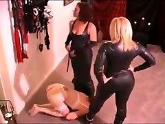 Lesbian slavegirl licks the boots of two superior mistresses