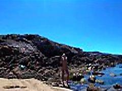 TRAVEL NUDE - Young vintage mature brunette nudist girl Sasha Bikeyeva on the wild coast ocean