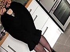 Red strips and fingers her pussy in the kitchen