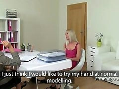 Female agent fucks blonde with strap on