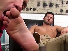 Hunk masturbates while his straight friend licks his feet