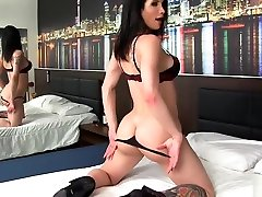 Transsexual Hottie Masturbates with a Huge Dildo