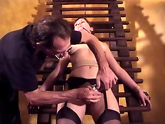 Big tits chick Audrey bound and gagged for a redhead titjob session