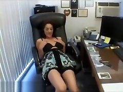 Brunette milf Bobbie fingering and toying in the office