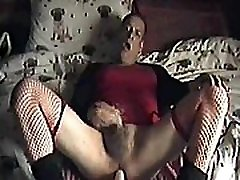bisexual crossdresser gets fucked by a dildo machine on full power while masturbaiting and shooting a cumshot at the same time