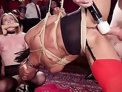 Ebony and brunette whipped at orgy