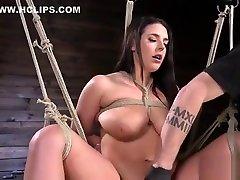 Monster tits slave gets caned in bondage