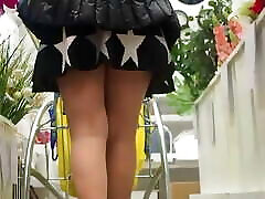 Woman in market upskirt high heels, pantyhose, nylons